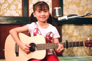 Lovely Girl Melts Hearts with Her Amazing Voice and Awesome Guitar Skills