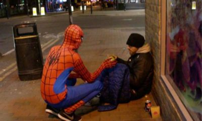 Spiderman feeds the homeless
