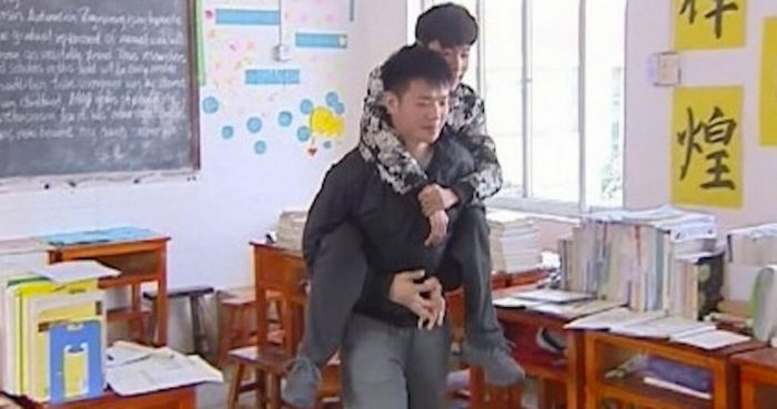pupil carries disabled friend 3