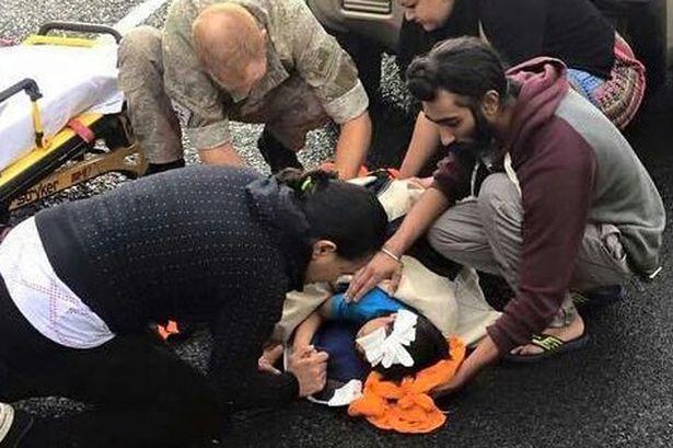 sikh man helps boy