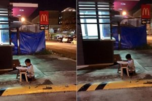 Inspiring Photo: The Child Studying at the Sidewalk