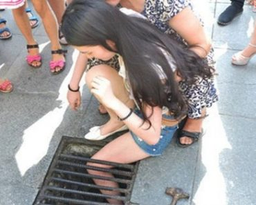 Chinese Girl Gets Stuck for Hours in Storm Drain after Falling while Texting