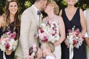 Cute Flower Girl Plants a Kiss on Ring Bearer during Her Mom's Wedding