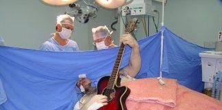 man plays guitar during brain surgery