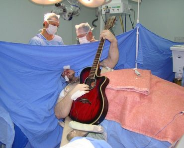 Man with Brain Tumor Plays the Guitar while Undergoing Brain Surgery