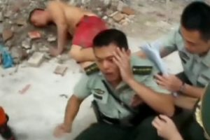 Policeman Catches Suicidal Man Who Jumps from a Four-Storey Building