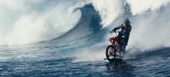 Motocross Stunt Rider Surfs the Ocean Waves on His Dirt Bike