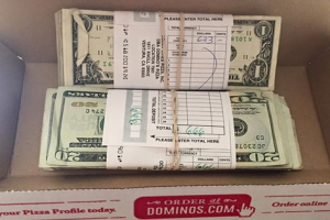 Guy Finds $1,300 in Delivery Box from Domino's Pizza