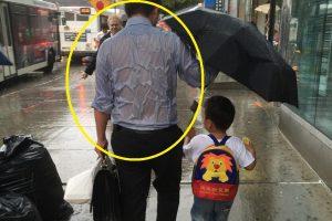 "Photo of the Rain-Soaked ""Umbrella Dad"" Goes Viral"