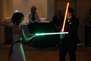 Newly-Wed Couple Skips First Dance For An Epic Lightsaber Battle