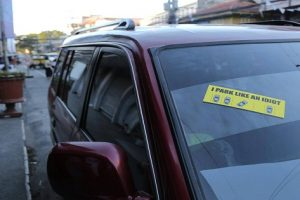 """A Group in a Philippine City Puts Stickers on """"Idiot"""" Drivers' Cars"""