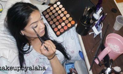 Pregnant woman applies makeup during labor