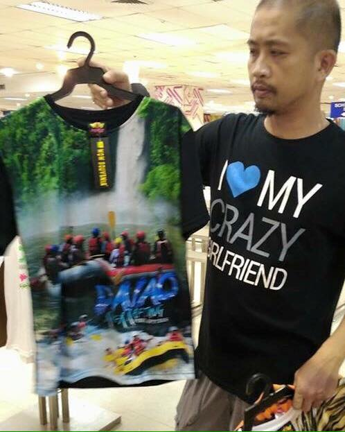 Rhonson Ng holding the Wow Souvenirs shirt with his waterfalls photo Photo credit: Rhonson Ng (Datu Maumpid) / Facebook