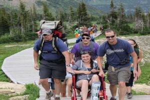 Husband's Family Took Turns Carrying Injured Woman So She Can Enjoy the Hiking Trip
