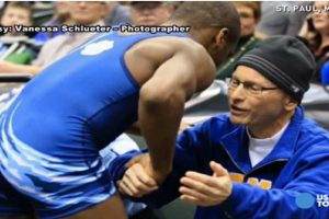 Teen Who Lost State Wrestling Competition Hugs Opponent's Dad