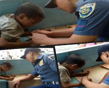 Cop Goes Viral for Teaching Poor Kid How to Write