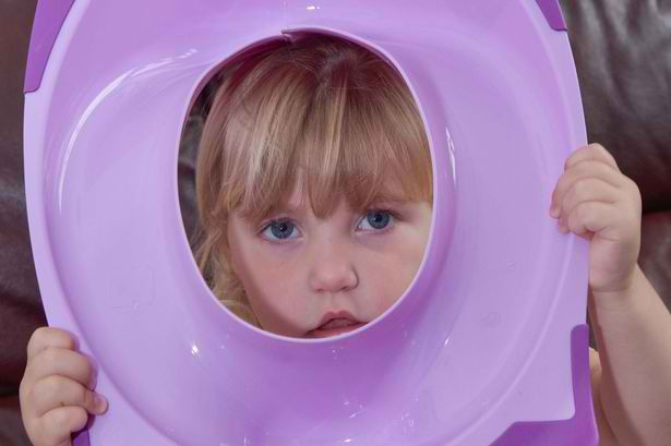 toddler head stuck on toilet training seat 1