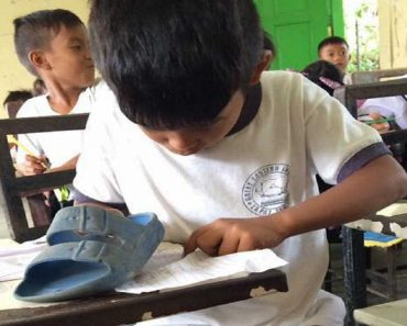 Poor Student Uses Slippers as Eraser