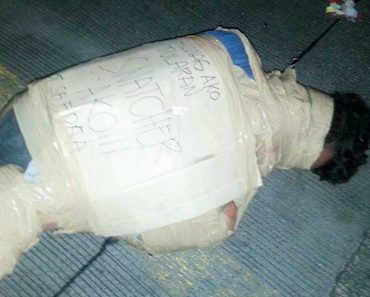 LOOK: Suspected Snatcher's Body Wrapped in a Box and Packaging Tape Found Along EDSA