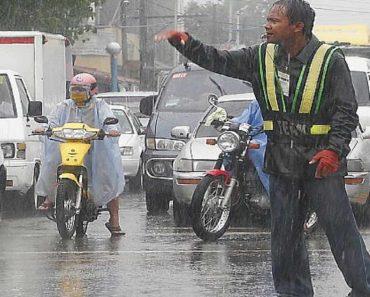 Traffic Aide Earns Praise for Not Leaving Post Amid Rain