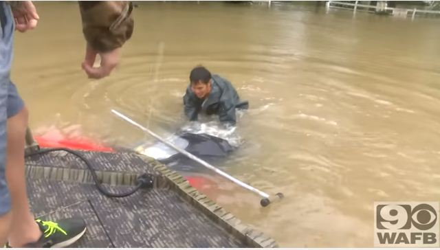 rescuing a woman and her dog in flood 3