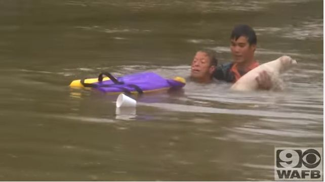 rescuing a woman and her dog in flood 5