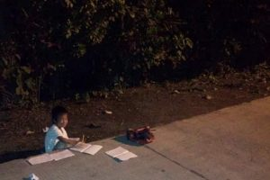 Photo of Boy Studying Under a Streetlamp Goes Viral