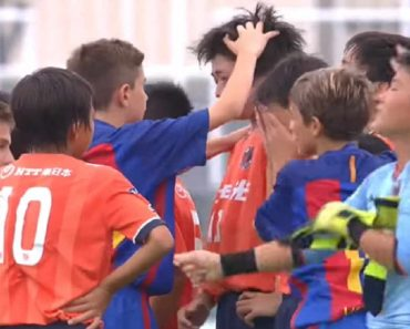 Young Barcelona Soccer Team Consoles Crying Japanese Opponents