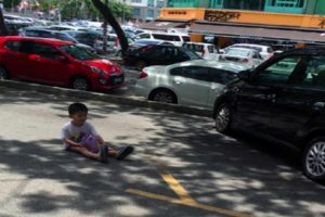 Photo of Kid Used by Mom to Reserve Parking Space Goes Viral