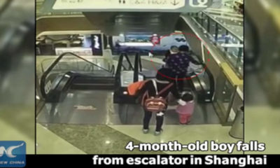 baby falls down escalator