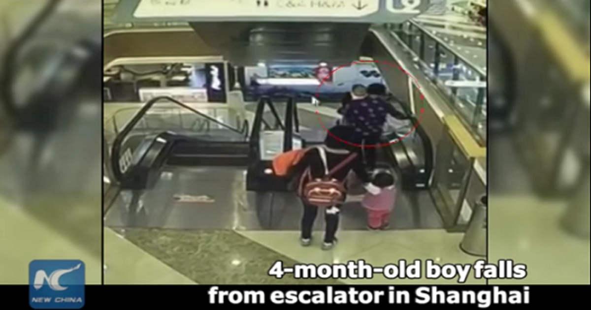 baby falls down escalator