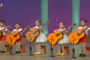 WATCH: Adorable Kids Amazingly Play Guitars They Could Barely Hold Properly