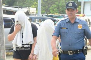 LOOK: Man and Alleged Mistress Arrested after Wife Reportedly Caught Them inside a Motel