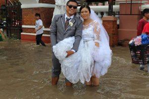 Photo of Newlyweds in Knee-Deep Flood Waters Goes Viral