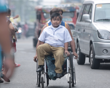 Disabled Dad Takes Son to School in His Wheelchair