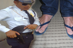 Kind Guard Lends His Shoes to Job Applicant Wearing Slippers