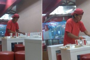 Old Man Cleaning Tables at Fastfood Outlet to Collect Food to Bring to Family