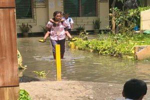 Public School Teacher Earns Praise for Carrying Students Across Flood Waters