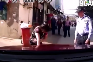 Chinese Woman Tries to Fake an Accident but Driver Ignores Her