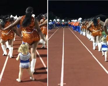 Adorable Girl Joins Cheerleaders in Half-Time Performance