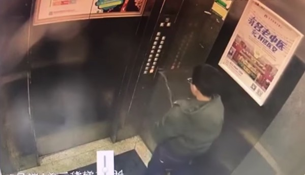 Before leaving the elevator, he decided to pee on the buttons. [Image Credit: Crazy China Videos / Youtube]