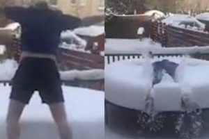 Father Happily Dives Into Thick Layer of Snow on His Children's Trampoline