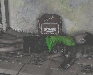 Photo of Homeless Boy Sleeping Beside His Dog Goes Viral