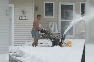 Dad Goes Viral for Clearing Snow While Wearing Shorts