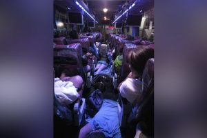 """Passengers Sleep on the Aisle after LTFRB Imposes """"No Standing Policy"""""""