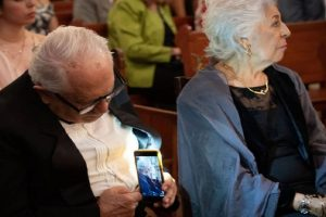 Old Man Goes Viral for Taking Photo of Wife at Granddaughter's Wedding