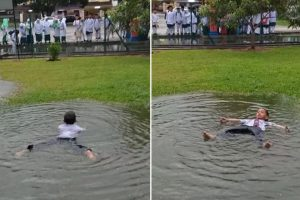 Carefree Boy Goes Viral for Swimming in Puddle Outside School
