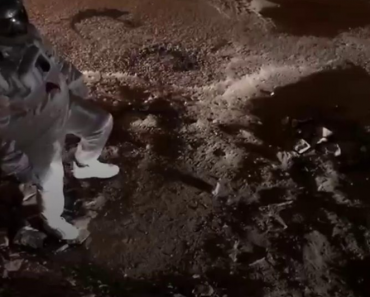 Man Pretends He's an Astronaut Doing Moonwalk in Street Filled with Potholes, Gov't Reacts