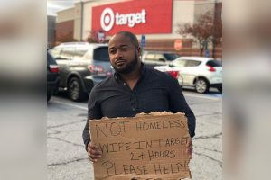 """Husband's """"I'm Not Homeless"""" Placard Over Wife Shopping at Target Goes Viral"""