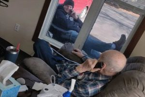 Sweet Photo of Son Chatting Up with Dad Outside Locked Down Aged-Care Facility Goes Viral